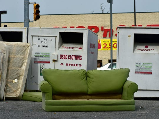 Furniture mattresses and junk are left in front of clothing donation bins at this spot along the 800 block of Lincoln Way West and other areas around Chambersburg and in townships.