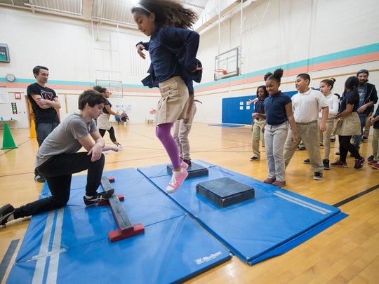 Kimberly DeJesus Alvarez makes a double jump during a parkour class at Lincoln Charter School in York. A York College student, Tim Dexter, visited the school to teach students about parkour, which he said is all about creative self expression through movement and overcoming obstacles.