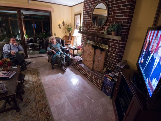 Hank and Bonnie McCann of Milford watch from their home as President Donald Trump makes his first congressional address. Hank McCann is chairman of the Kent County Republican Executive Committee.