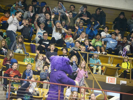 Basketball fans wave and shout at Western Carolina's mascot, Paws, during the opening game of the Southern Conference Tournament between WCU and Chattanooga March 2, 2017.