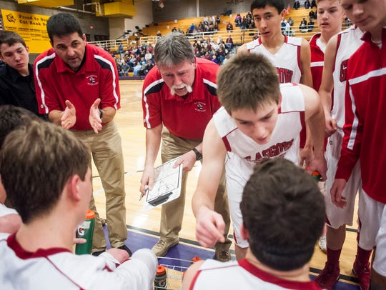Glasgow Head Coach Norm Braaten (center, red shirt) speaks to his team while Bryce Legare gives a pep talk to Trent Herbert during a 2017 Northern B Divisonal game against Shelby at Cut Bank High School.