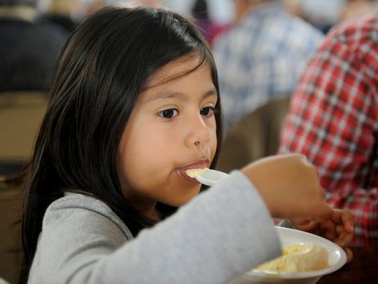 Valentina Martinez enjoys her ice cream during the