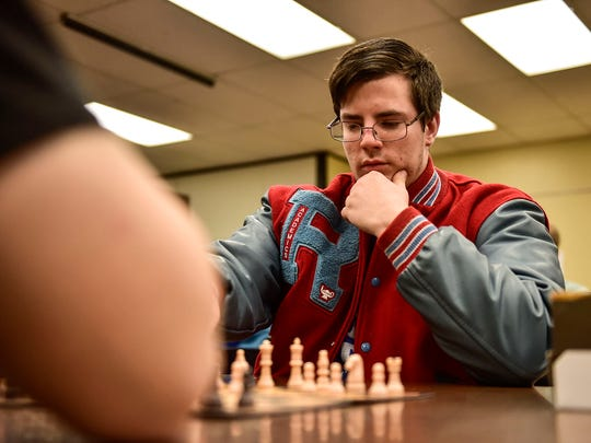 Ridgedale senior John Howlett carefully ponders his next move during his chess game with sophomore Owen Sullivan.