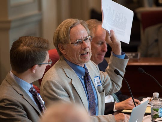 Paul H. Robinson, center, a University of Pennsylvania Law School professor, addresses the Joint Finance Committee concerning rewriting the state's criminal code in 2016.