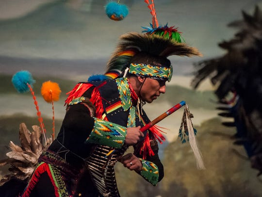 Brandon Racine performs in prairie chicken dancer regalia during the Story of the Painted Robe dance by the Missouri River Dance Company in the Heritage Inn.