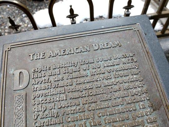 A plaque at the site of the Boston Irish Famine Memorial.
