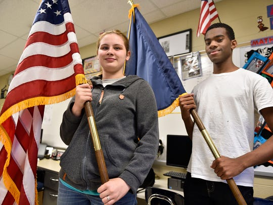 Life Skills students Shanna Beach and Jaylen Thomas, both sophomores, hold an American flag and state flag on Tuesday, May 9, 2017 that will be donated to Chambersburg Area Senior High School. Students used profits from their coffee shop to purchase the flags.