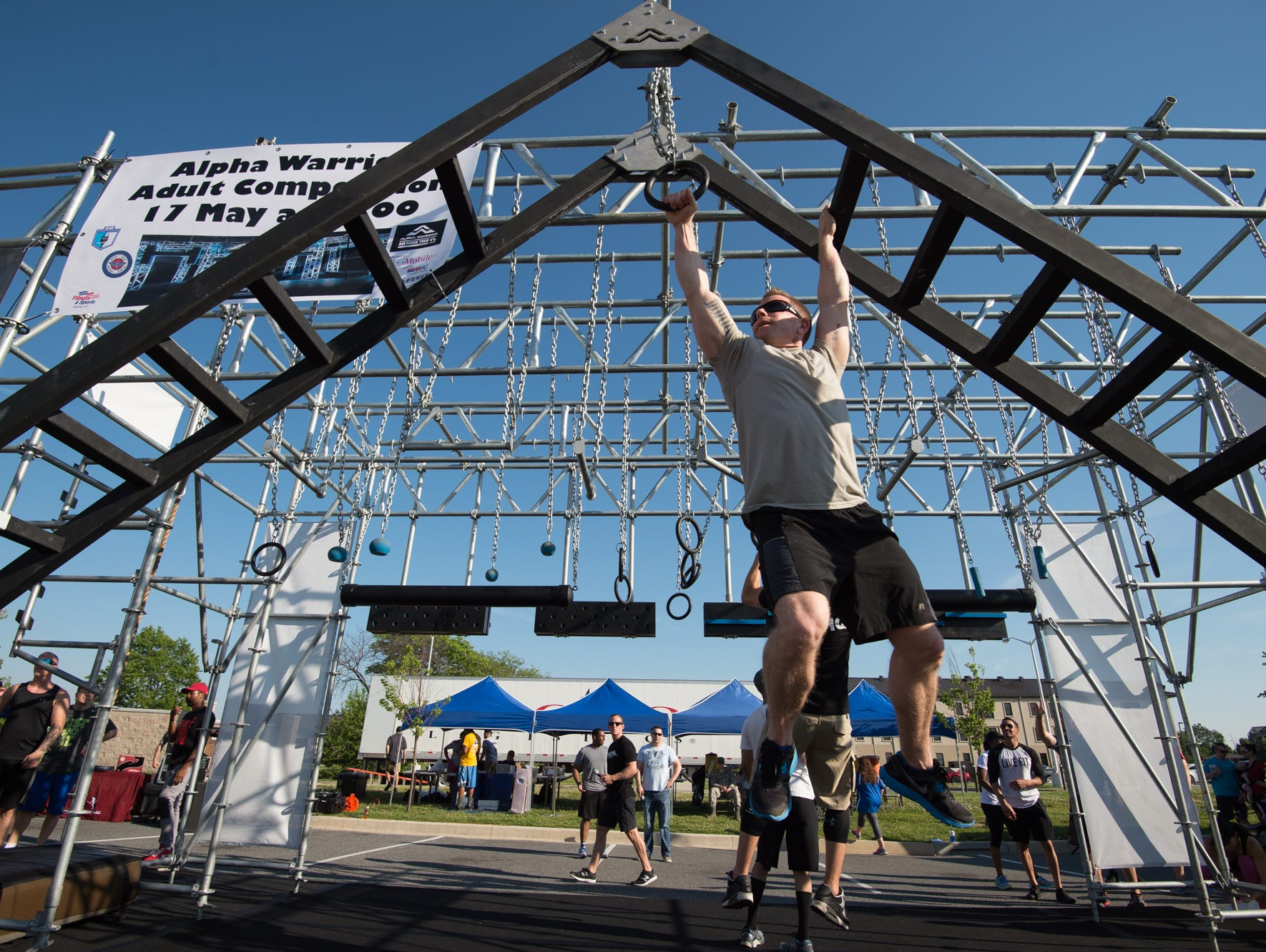 """Air Force airmen competed on a timed obstacle course modeled after the TV series """"American Ninja Warrior."""""""