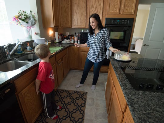 Kim Petters, an Air Force veteran with PTSD, with her son, Matt (5), at their home in Magnolia.