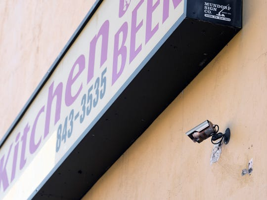 A security camera on the side of Li's Kitchen.