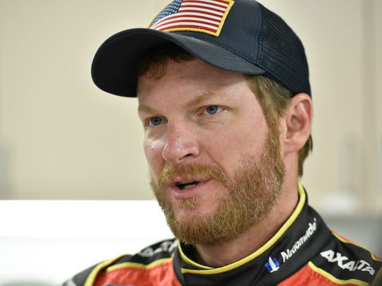 Dale Earnhardt, Jr. talks with members of the media during a tire testing session at Dover International Speedway in Dover.