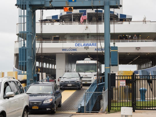 Vehicles driving off the Cape May-Lewes Ferry at the