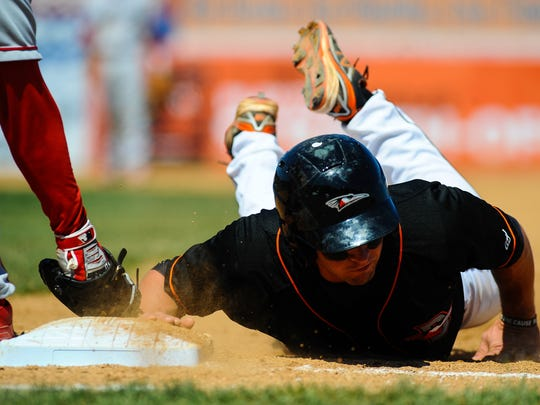 Shorebirds first baseman Trey Mancini slides into first to beat a pickoff throw on Sunday afternoon at Perdue Stadium in Salisbury.