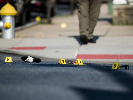 Sunglasses and a sandal lie on the ground as police investigate a shooting that occurred at the intersection of Ninth and Mifflin streets around 4:30 p.m. on Wednesday, August 16, 2017. The shooting sent one woman to the hospital.