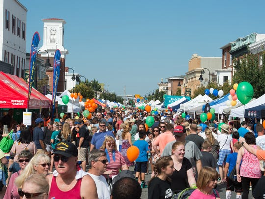 Festivalgoers shop the vendor booths at the 24th annual Middletown Old-Tyme Peach Festival, a mainstay of downtown Middletown.