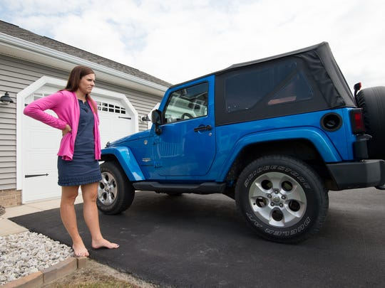 Jenna Hitchens with her Jeep Wrangler that she purchased with her settlement money.