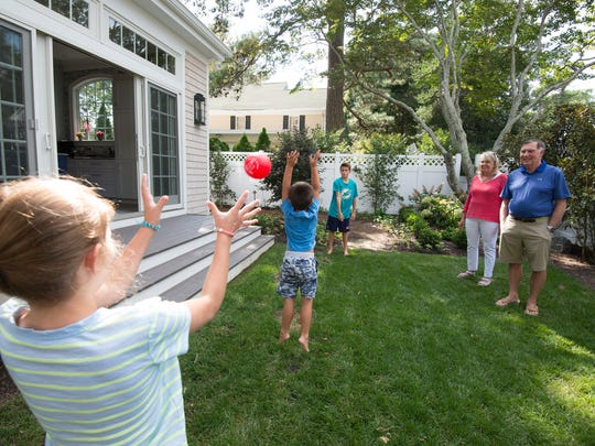 Barry Covington and his wife Sharon and their grandchildren Sean Harmon (12), Michaela Harmon (9) and Liam Harmon (4) in their backyard where they wanted to install a pool at their home in Rehoboth Beach.