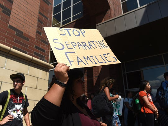 People gather on the campus of the University of Nevada, Reno to protest the ending of the DACA program on Sept. 5, 2017. Jason Bean/Reno Gazette-Journal- USA TODAY NETWORK