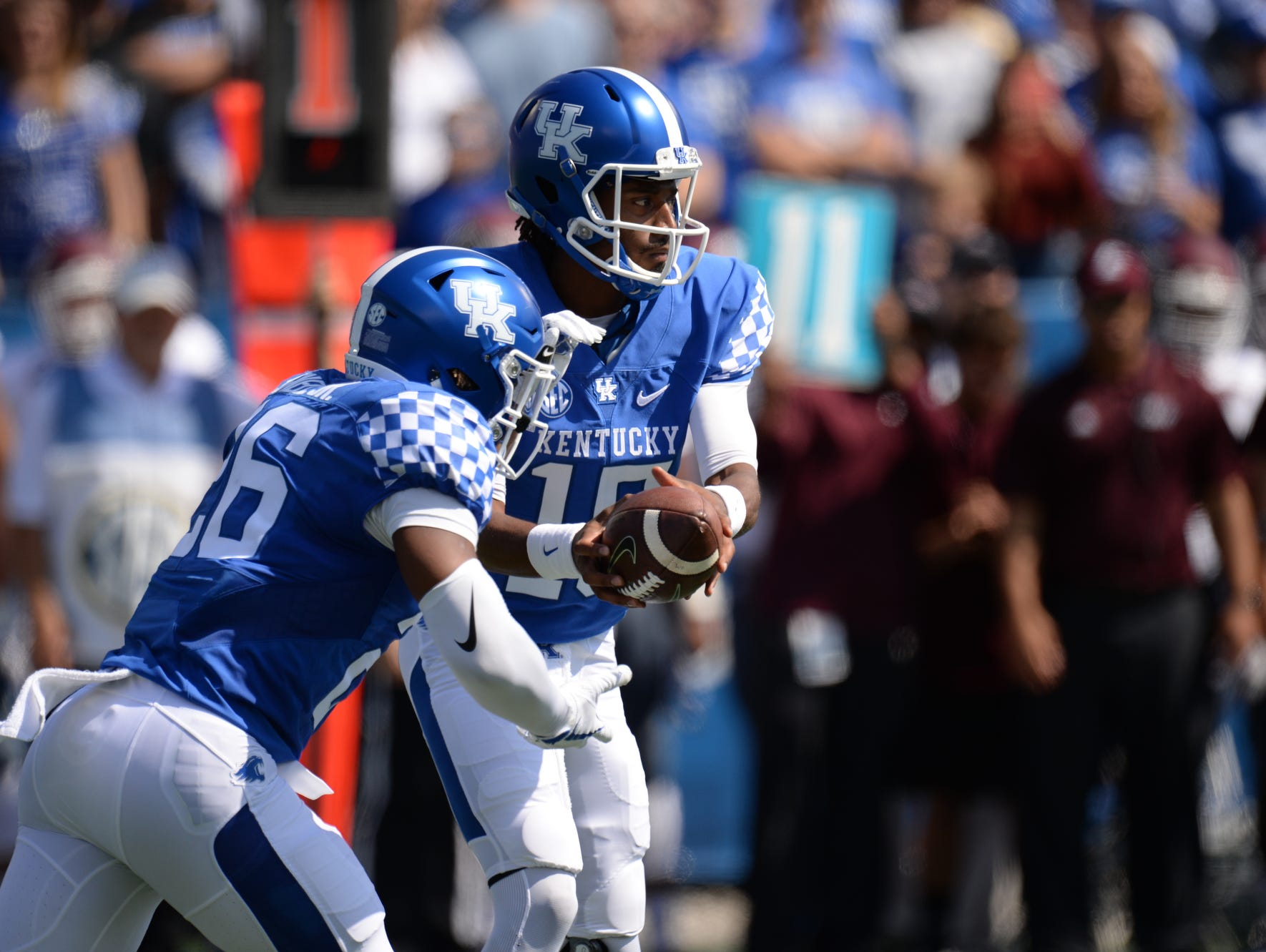 UK QB Stephen Johnson hands off the ball to RB Benny Snell Jr. during the University of Kentucky football game against Eastern Kentucky University in Lexington, KY on Saturday, September 9, 2017.