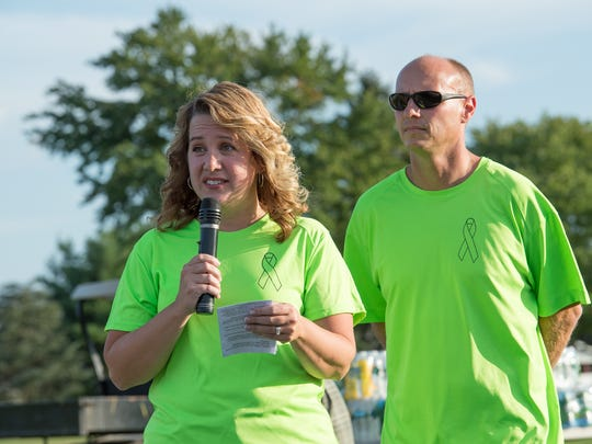 Gina and Dain Kleiv, parents of second-grader Von Kleiv, 7, who was diagnosed with lymphoma in 2016 address the attendees at Laps For Lymphoma fundraiser at Major George S. Welch Elementary School on Dover Air Force Base.