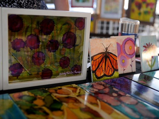 Artwork by Cindy Kahler Thomas is displayed at her booth during the final Art Walk of 2017 Thursday, Oct. 5, 2017, at the downtown Farmer's Market. The 2019 season kicks off from 6 to 9 p.m. Thursday with such attractions as Wichita Falls City Council Member Eric West, a musician, performing live.  The Wichita Falls Farmers Market serves as a focal point for the Downtown Wichita Falls Development Inc. festivities.