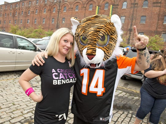 Fans turned out to tailgate for the Cincinnati Bengals home game against the Buffalo Bills on Sunday, October 8, 2017. Mollie and Matt Scroggin of Middletown.