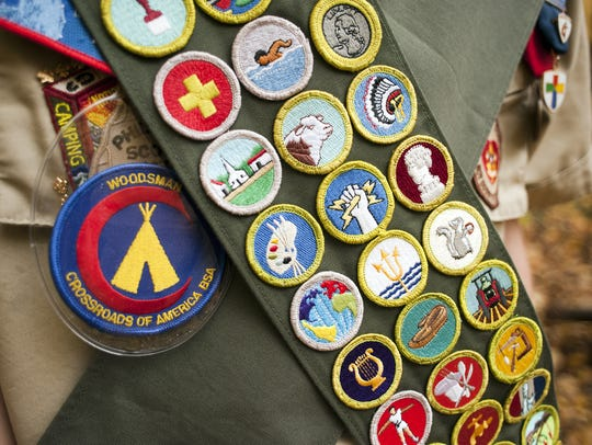 An Eagle Scout displays the 133 merit badges awarded