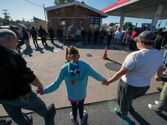 "In this file photo from Oct. 17, 2017, friends gather for a prayer vigil for Aditya ""Sunny"" Anand, 44, of York, at the Exxon convenience store on West Market Street and South Richland Avenue in York.  He was fatally shot during an attempted robbery at the store."