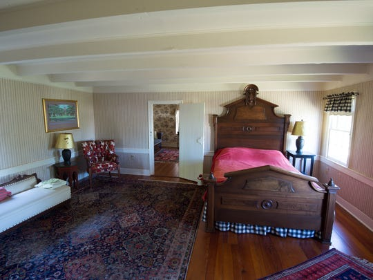 Woodwork in the bedrooms adds to the vintage feel of Sudler House in Bridgeville.
