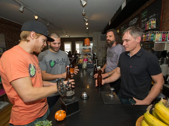 (L-R) Stu Blake of Dover, Co-owner of 2nd Act Beer, 2nd Act Beer co-owner Brandon Galluppi of Dover, Craig Cirinelli of Boonton and lead singer of the band Hidden Cabins, and Frankie McDonald of Bootnon, owner of Boonton Coffee, sample the new beer at Boonton Coffee in Boonton, October 19, 2017. Photo by Warren Westura for the Daily Record.