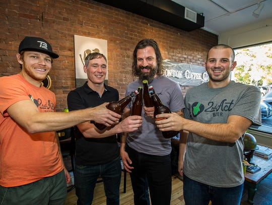 (L-R) Stu Blake of Dover, Co-owner of 2nd Act Beer, Frankie McDonald of Boonton, owner of Boonton Coffee, Craig Cirinelli of Boonton and lead singer of the band Hidden Cabins, and 2nd Act Beer co-owner Brandon Galluppi  of Dover toast the new beer at Boonton Coffee in Boonton, October 19, 2017.