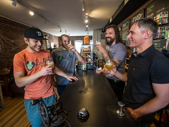 (L-R) Stu Blake of Dover, Co-owner of 2nd Act Beer, 2nd Act Beer co-owner Brandon Galluppi of Dover, Craig Cirinelli of Boonton and lead singer of the band Hidden Cabins, and Frankie McDonald of Boonton, owner of Boonton Coffee, sample the new beer at Boonton Coffee in Boonton, October 19, 2017. Photo by Warren Westura for the Daily Record.