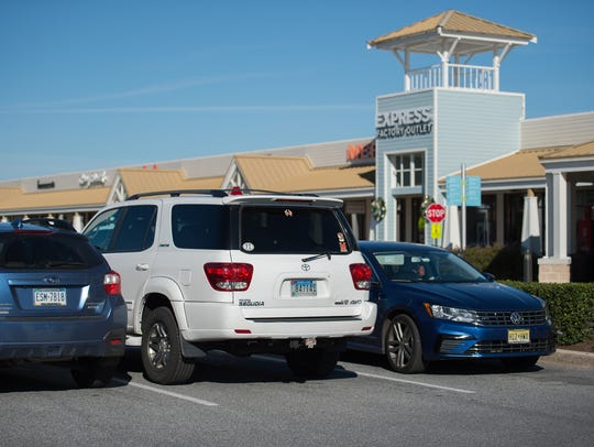 View of out-of-state cars parked at Tanger Outlets