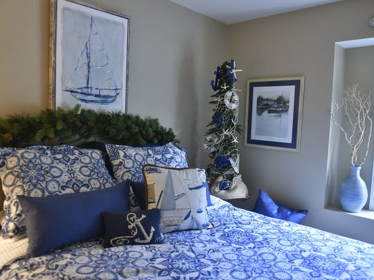A tabletop nautical Christmas tree tucked the corner matches the theme in the spare bedroom at the Warner home.