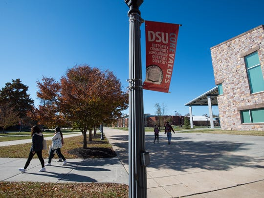 Students walk outside the Martin Luther King Jr. Student Center at Delaware State University in Dover.