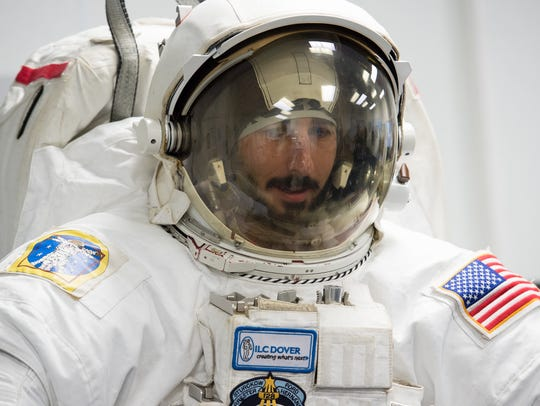 Jim Connolly performs a test on a astronaut space suit