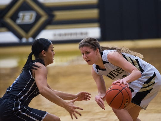 Biglerville's Rebecca Isaac tries to move the ball