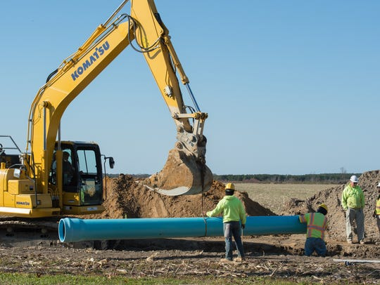 Piping is being laid along Route 30 to transport wastewater