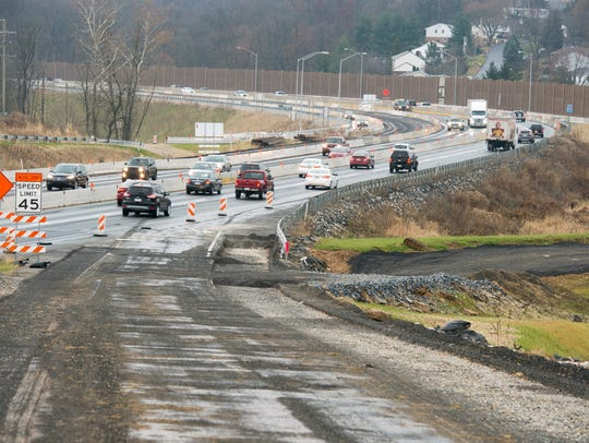 The former southbound on-ramp to Interstate 83 is gradually