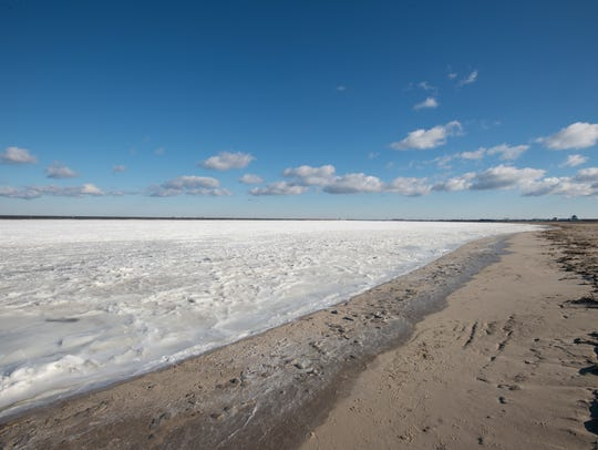 View of areas of frozen water at Lewes Beach.