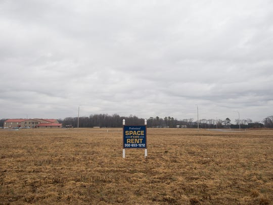 A sign at the Independence Commons business park in Milford advertises space for rent in existing buildings in the business park.