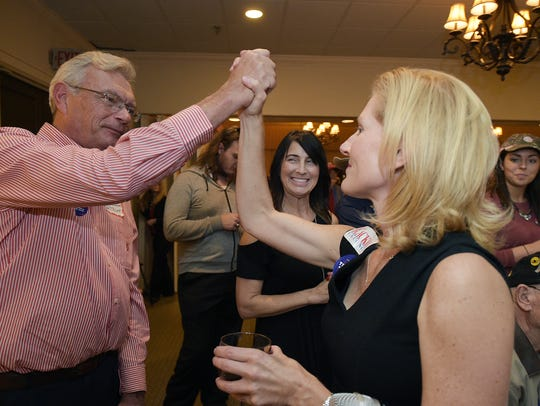 Williamson County Republican Party chairman Julie Hannah, right, high-fives a Trump supporter during a election night watch part at Old Natchez Country Club in Franklin on Nov. 8, 2016.