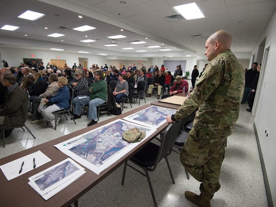 1LT James Willey with the Delaware Army National Guard stands next to maps of the town of Blades during an informational meeting concerning the PFCs that were found in public drinking wells. The Delaware Army National Guard has been distributing bottled and bulk water to residents who have been told not to drink or cook with the tap water.