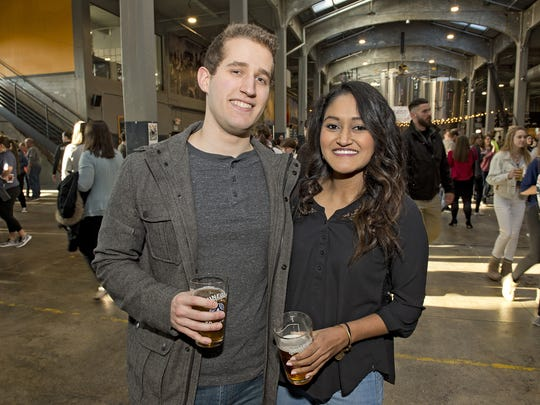 Zoogeist, an event to benefit the Cincinnati Zoo and Botanical Gardens, took place at Rhinegeist Brewery in Over-the-Rhine on Thursday, March 15, 2018. Will Kowite and Shay Ramani of Oakley enjoy some brews on the main floor of the brewery.