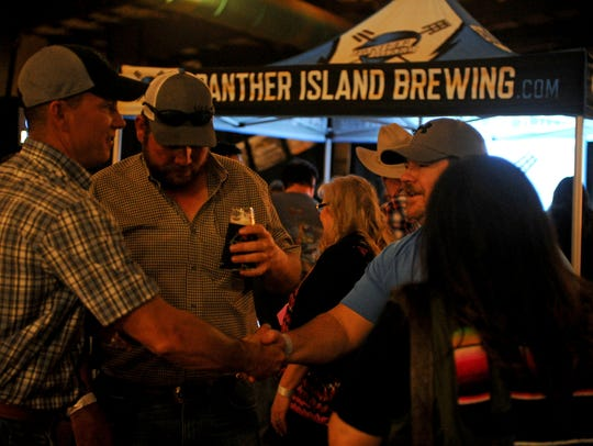 People sample different beers in the beer garden at