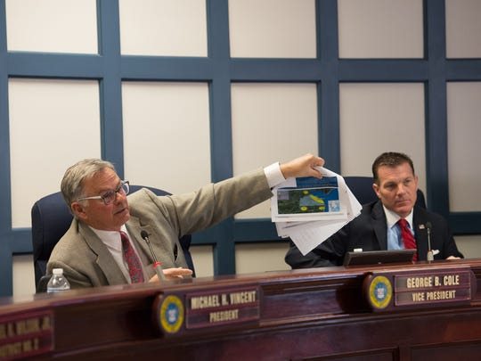 Sussex County Council vice president, George B. Cole, questions attorney James Fuqua about a Sussex County growth map during a public hearing concerning the proposed Overbrook Town Center.