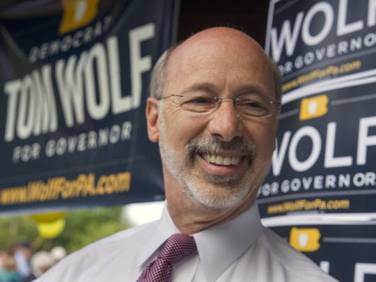 In this file photo, Tom Wolf talks to the media after a rally in Mount Wolf in on May 18, 2014.