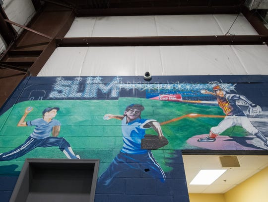 View of the mural dedicated to Slim's Sports Complex owner Steve Duncan's brother whose nickname was Slim.