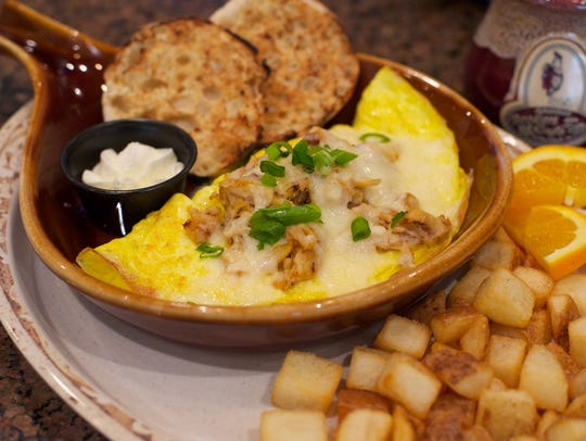 "Another Broken Egg Cafe's ""The Floridian"" omelet features"