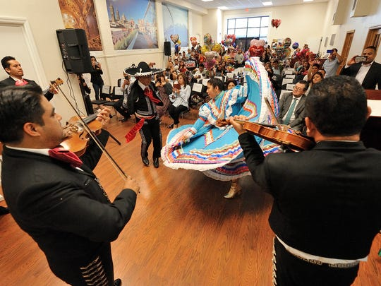 Dancers and musicians perform at the reunification party held at the Mi Casa es Puebla in Passaic on Tuesday, June 5, 2018.